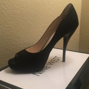 Black suede high heels. It's a perfect party shoe